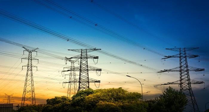 sun setting behind the silhouette of electricity pylons 1127 2986 उत्तर प्रदेश: निकाय चुनाव खत्म होते ही लोगों को लगा बिजली का झटका, सरकार ने बढ़ाए दाम